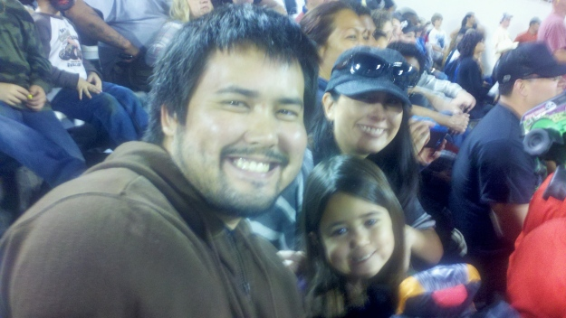 Richard (my brother), Mia, and Christine having fun watching the Monster Jam!