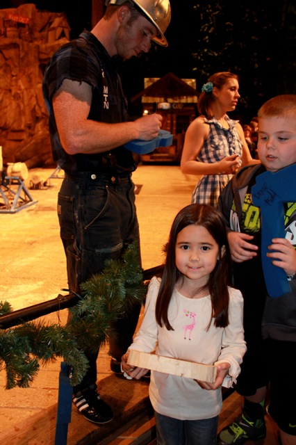 Mia getting her cookie signed at the Lumberjack Feud show!