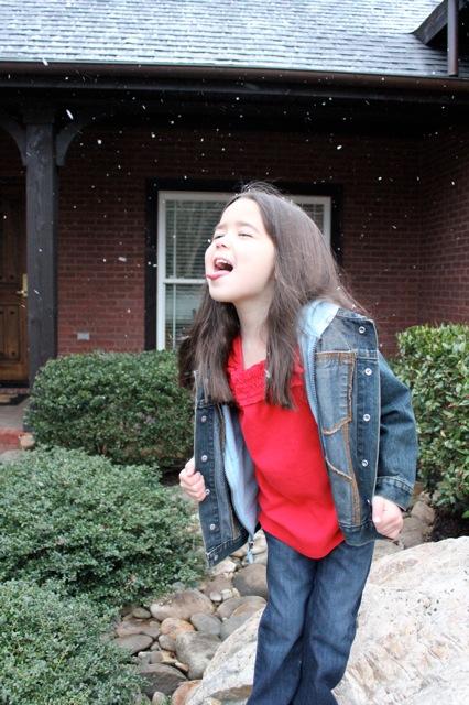 Mia catching snowflakes!