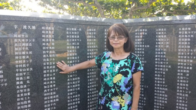 My mom at the WWII memorial site.  She is pointing out her uncle and great grandfather.