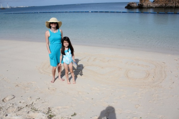Mia and I on the beach. Mia and her daddy drew a note in the sand for me. :)