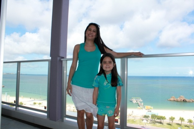 Mia and I on the balcony where we are staying in Okinawa... very close to where I was born! June 9, 2013. — at Okinawa|沖縄.