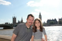 Mia and Danny in front of the Thames River with Big Ben in the background.