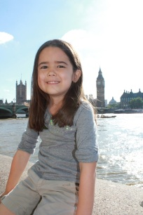 Mia in front of the Thames River with Big Ben in the background.