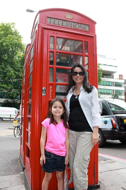 "Mia and I in front of classic red telephone booths.  Mia asked, ""What's a telephone booth?!?!"" :)"
