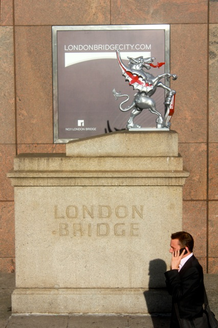 I thought this photo ended up interesting since I took it so quickly... with the guy on the phone walking in front of the London Bridge Sign.