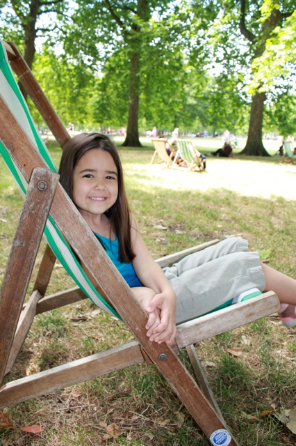Mia sitting on one of the green & white relaxing chairs at St. James's Park.