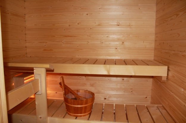 Our sauna has two platforms to lay on and a moveable bench on the floor.
