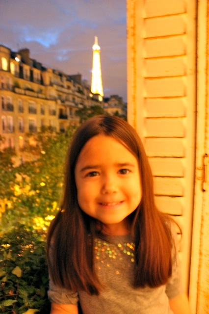 Mia at our hotel widow with a beautiful view of the Eiffel Tower in the background.