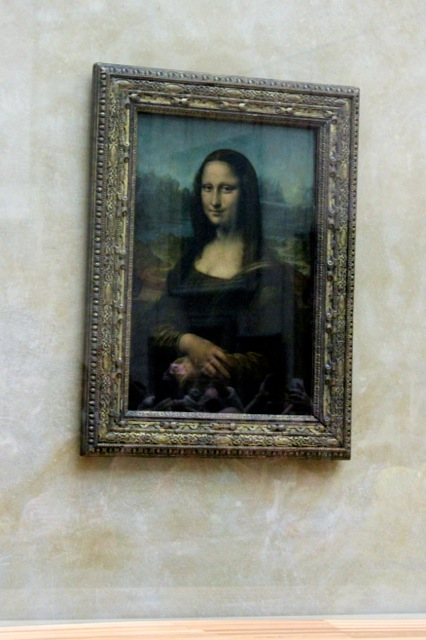 Leonardo de Vinci's Mona Lisa portrait at the Louvre.  The most famous work of art in the world....