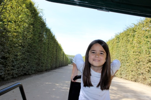 Mia having fun on the golf cart while touring the gardens.