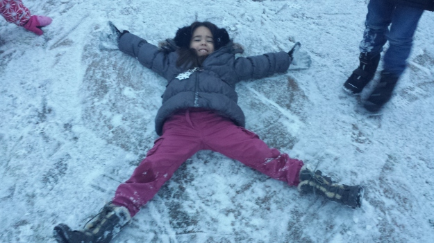 Mia's first time trying to make a snow angel!