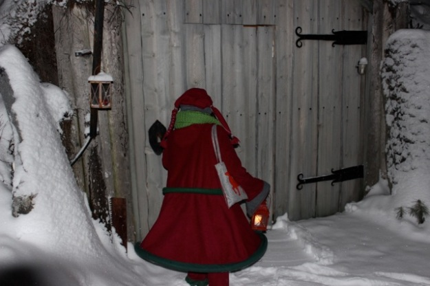 The elf doing the secret knock to enter Santa's Home.