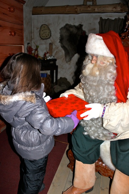 Mia receiving her special gift from Santa!