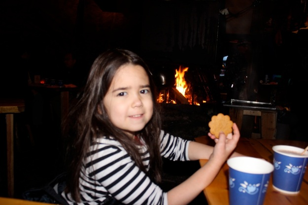 Mia enjoying a gingerbread cookie after enjoying the yummy Salmon.