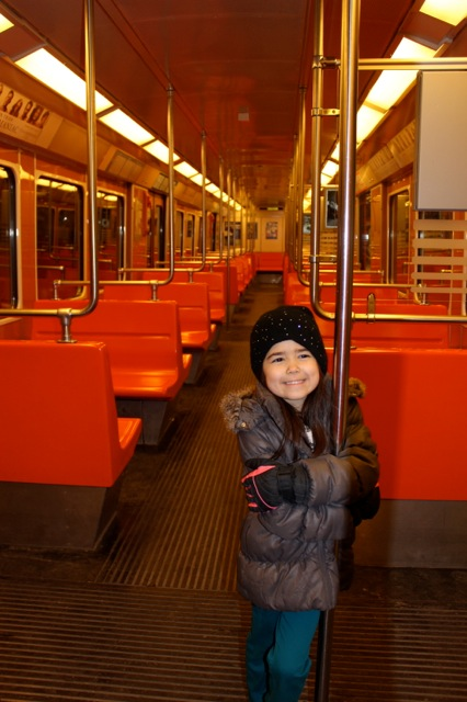 Mia having fun one day on the metro.  Hmmm... I wonder where everyone was that day?