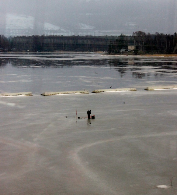 I spotted this guy ice fishing while on a ride on the metro.