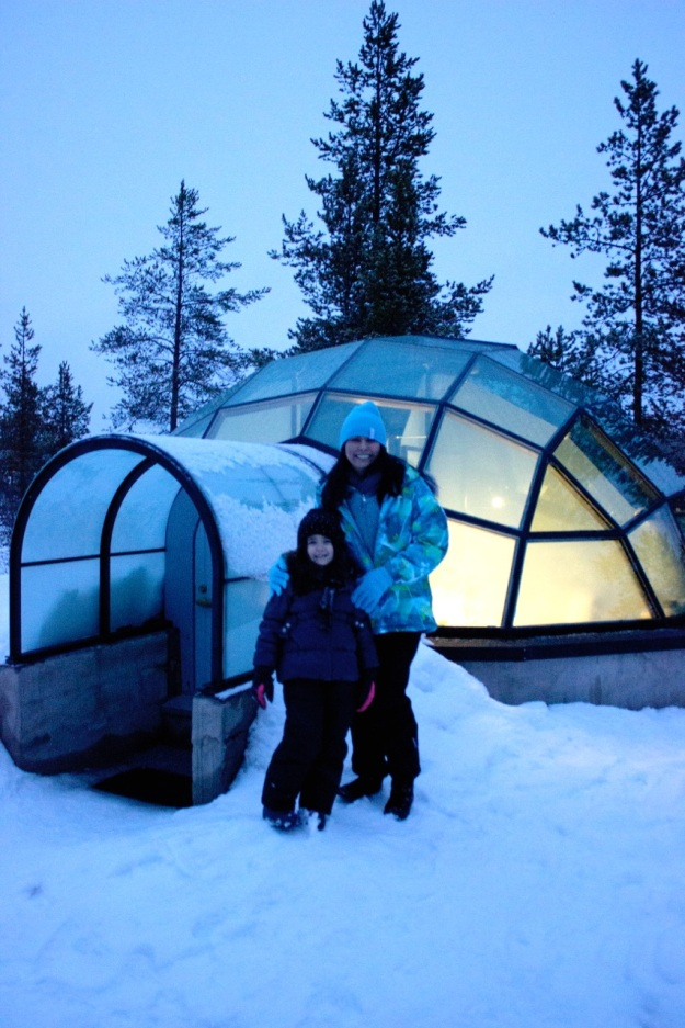 This is Mia and I in front of one of the beautiful glass igloos lit up before dark.