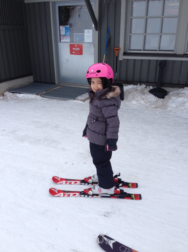 Mia with a pair of snow skis on for the first time!