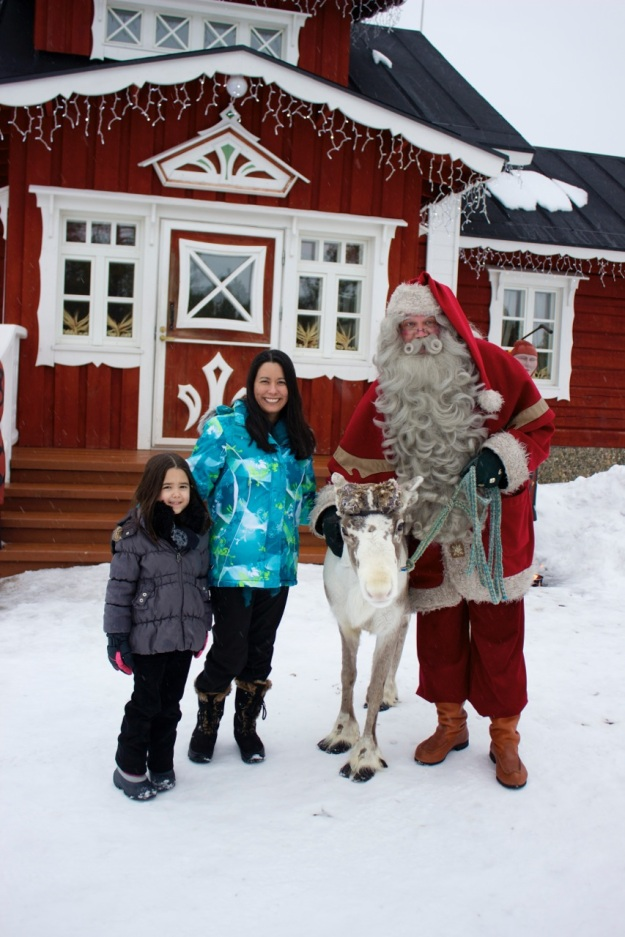 Mia and I with Santa and one of his reindeer at Santa's Resort.