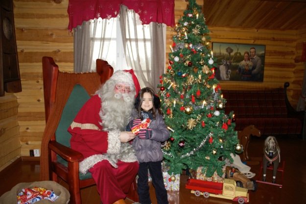 Mia with Santa in his cottage. He gave her a nice gift as well!