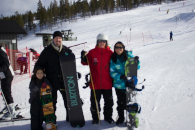 This one is a bit blurry (forgot to change the settings).  This is our family with our amazing ski instructor, Leen! :)