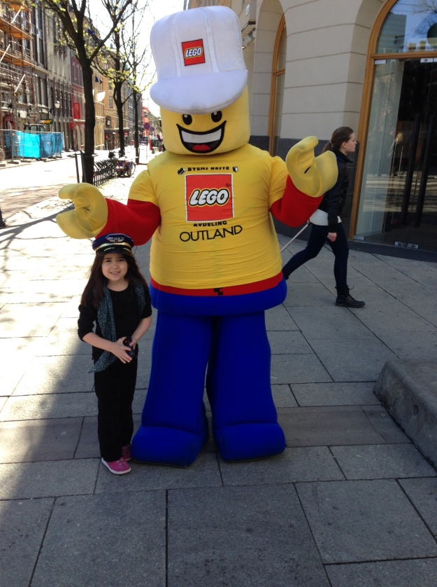 Mia with the Lego Mascot  in the streets of Oslo, Norway.