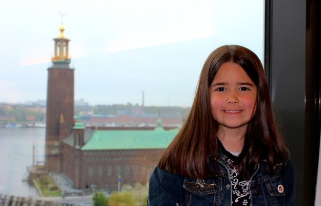 Mia in our hotel room, we had a lovely view of harbor and The City Hall of Stockholm (which has 3 crowns at the top of the tower).