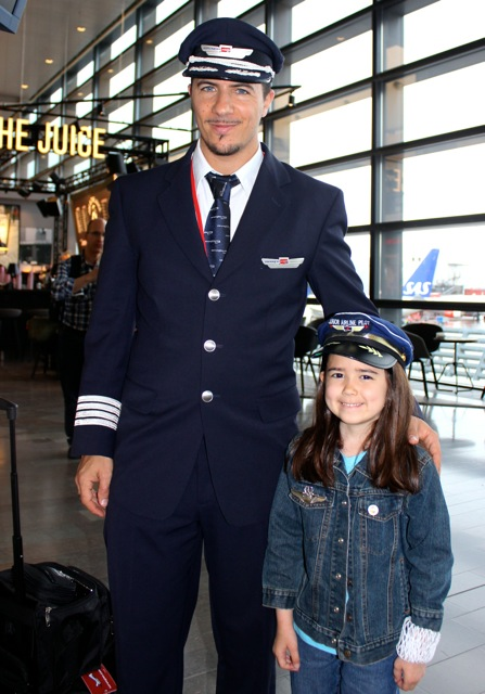 We never leave to travel without Mia's Junior Pilot hat.  We have always wanted to get a picture of her and a real pilot with their hat on too.  We finally found a nice pilot at the Stockhom Airport who was happy to take a picture with her.  We do not know his name, but a great big Thank You to this Norwegian Airlines Pilot! :)