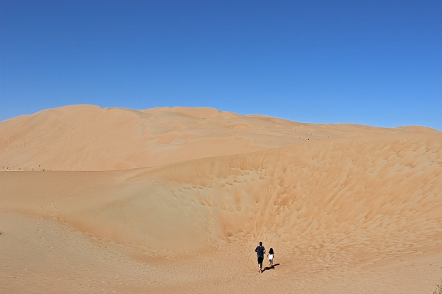 "Danny and Mia showing off the ""Scale"" of the Rub' al Khali (The Empty Quarter) desert."