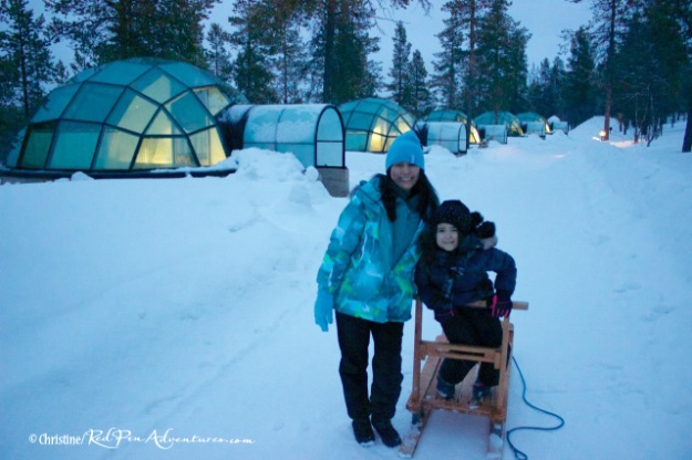 Mia and I in front of the glass igloos in Finland.
