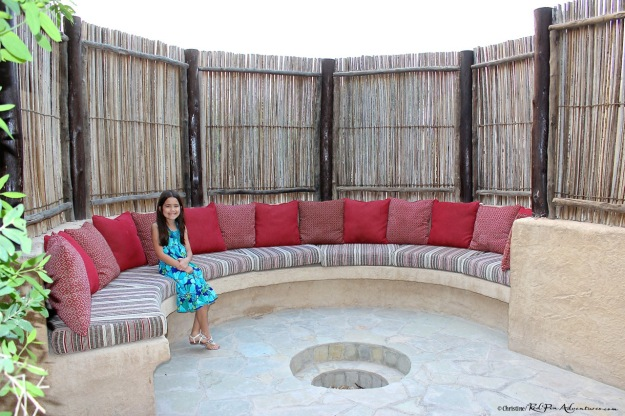 Mia at the fire pit area at our villa.