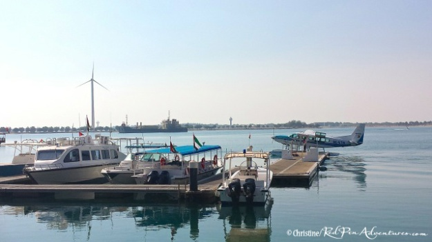 The boats and a seaplane at the dock on Sir Bani Yas Island.