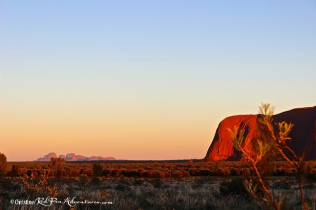 This shot shows the left end of Ayers Rock as well as a view of Kata Tjuta in the distance.