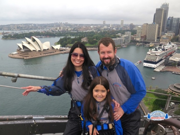 My family and I with the stunning Sydney Opera House in the background! Luckily, it hadn't started raining yet when we made it to this part of the bridge climb!